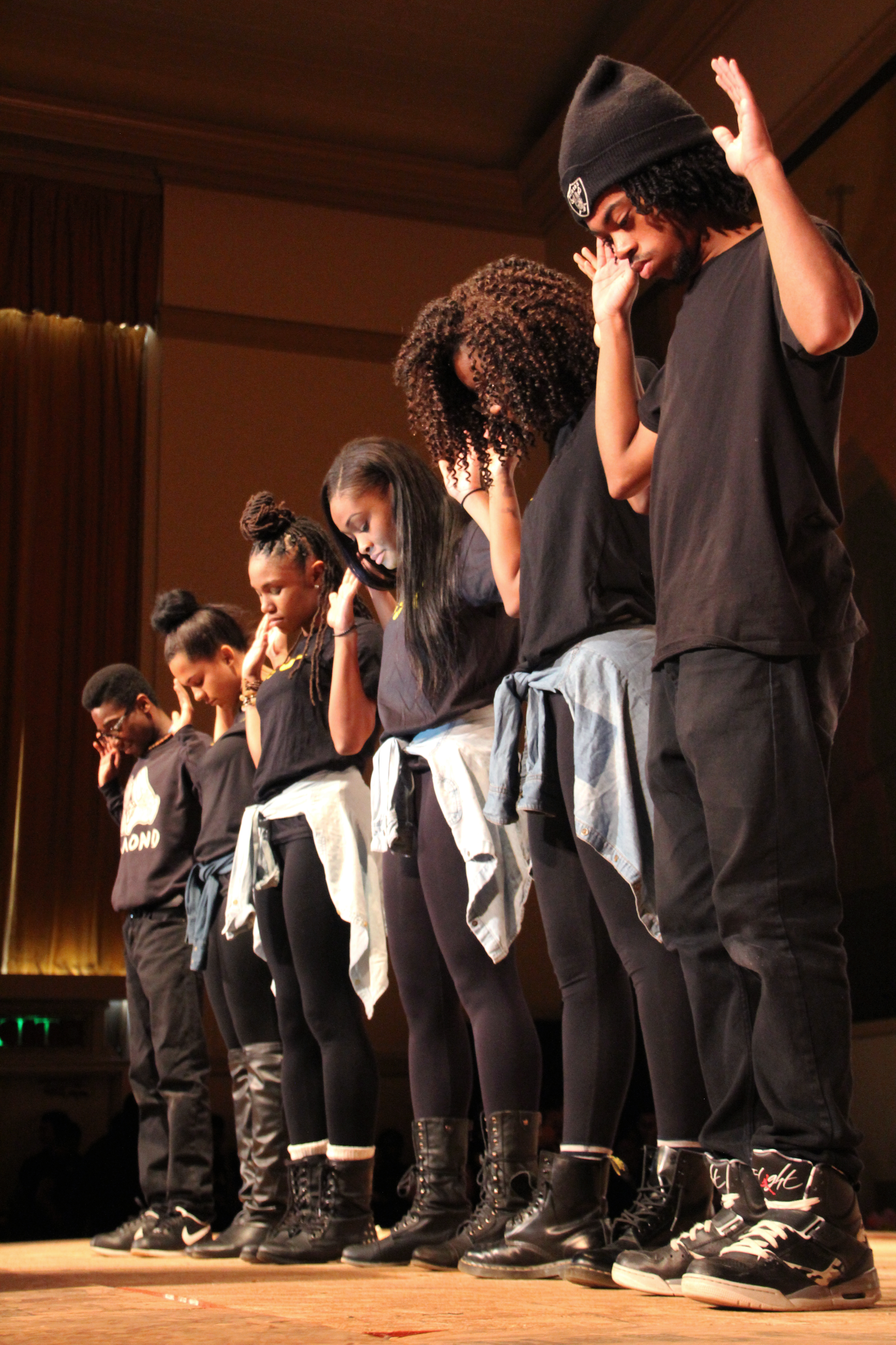 """Members from Grant High's Black Student Union stand in solidarity with their arms raised, symbolizing the Civil Rights tag """"Hands up, Don't Shoot"""" at the recent Black History Month assembly. This year, the BSU member chose to raise awareness to the current struggles of African Americans for the assembly."""