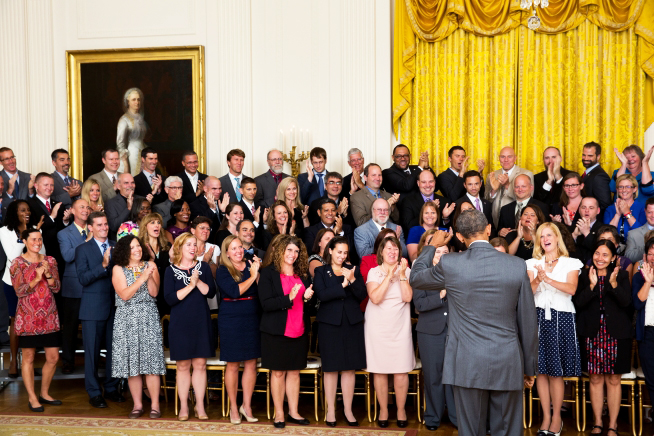 Schraer far left, applauding with 99 of the awardees from around the country when Obama walked into the room to greet them.